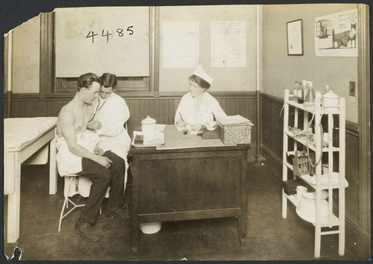 Mulberry Health Center Album -- Doctor Checking Heartbeat of Man