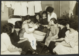 Mulberry Health Center Album -- Nurse Demonstrating with Doll