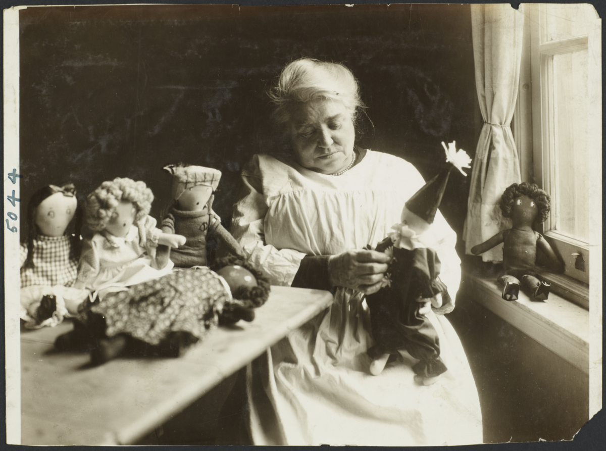 Women's Work Rooms Album -- Old Woman Making Dolls