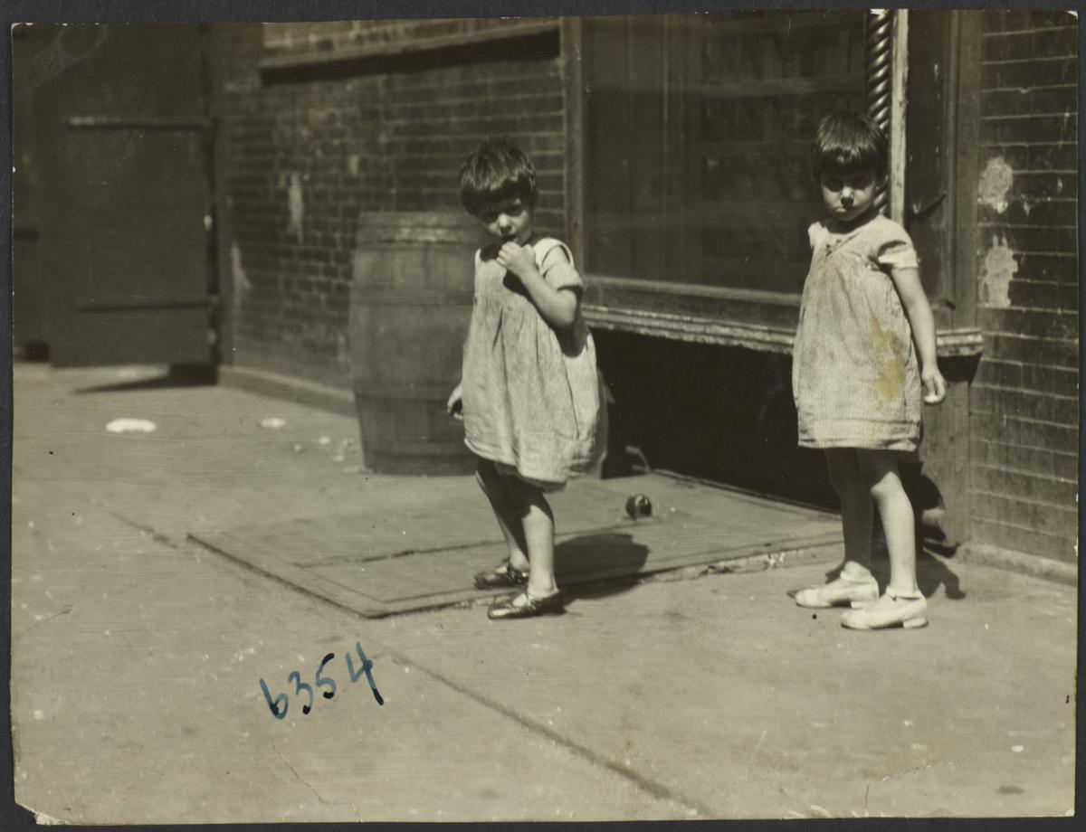 Twin Girls on Sidewalk
