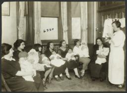 Mulberry Health Center Album -- Woman  Showing Medicine to Mothers and Children