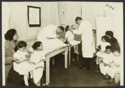 Mulberry Health Center Album -- Doctors with Children