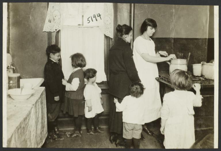 Mulberry Health Center Album -- Women with Children in a Kitchen