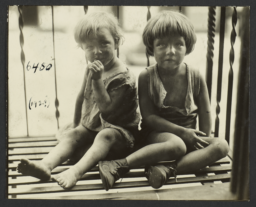 Close Up of Two Children on Fire Escape