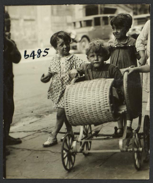 Girl Pushing Boy in Pram