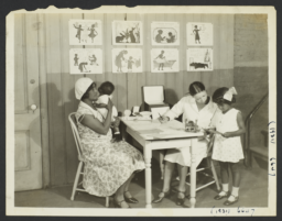 Columbus Hill Health Center Album -- Nurse with Mother and Children at Columbus Hill Health Center