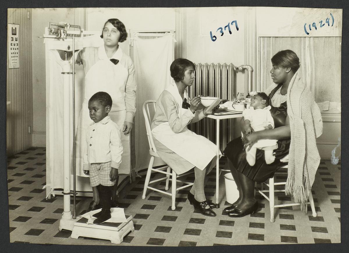 Columbus Hill Health Center Album -- Weighing Child at Columbus Hill Health Center