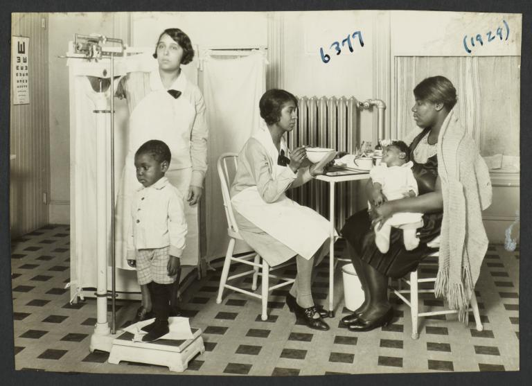 Columbus Hill Health Center Album -- Weighing Child at Columbus Hill Health Center