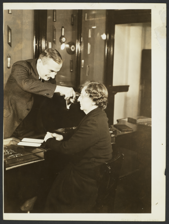 Man Fixing Woman's Glasses