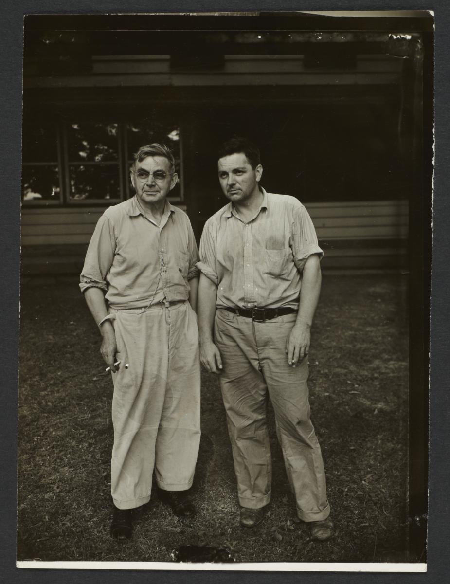 Two Men Outside Building