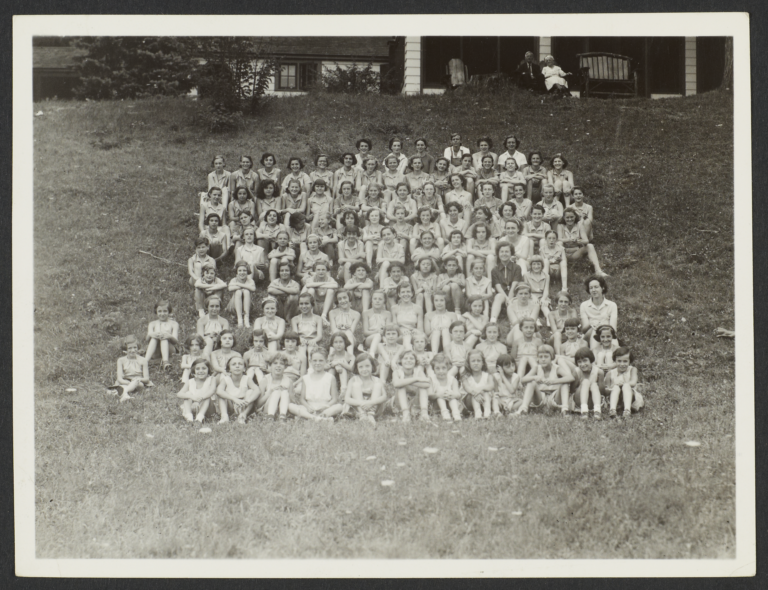 Group of Campers Seated on Hill