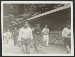 Boys Walking near Cabin