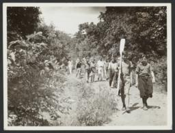 Boys Walking with Oars