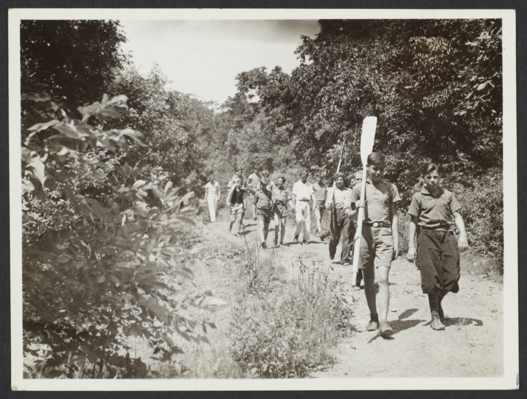 Boys Walking with Oars