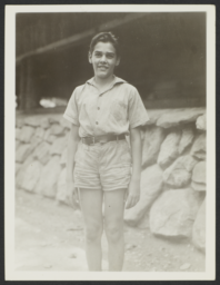 Boy in Front of Cabin