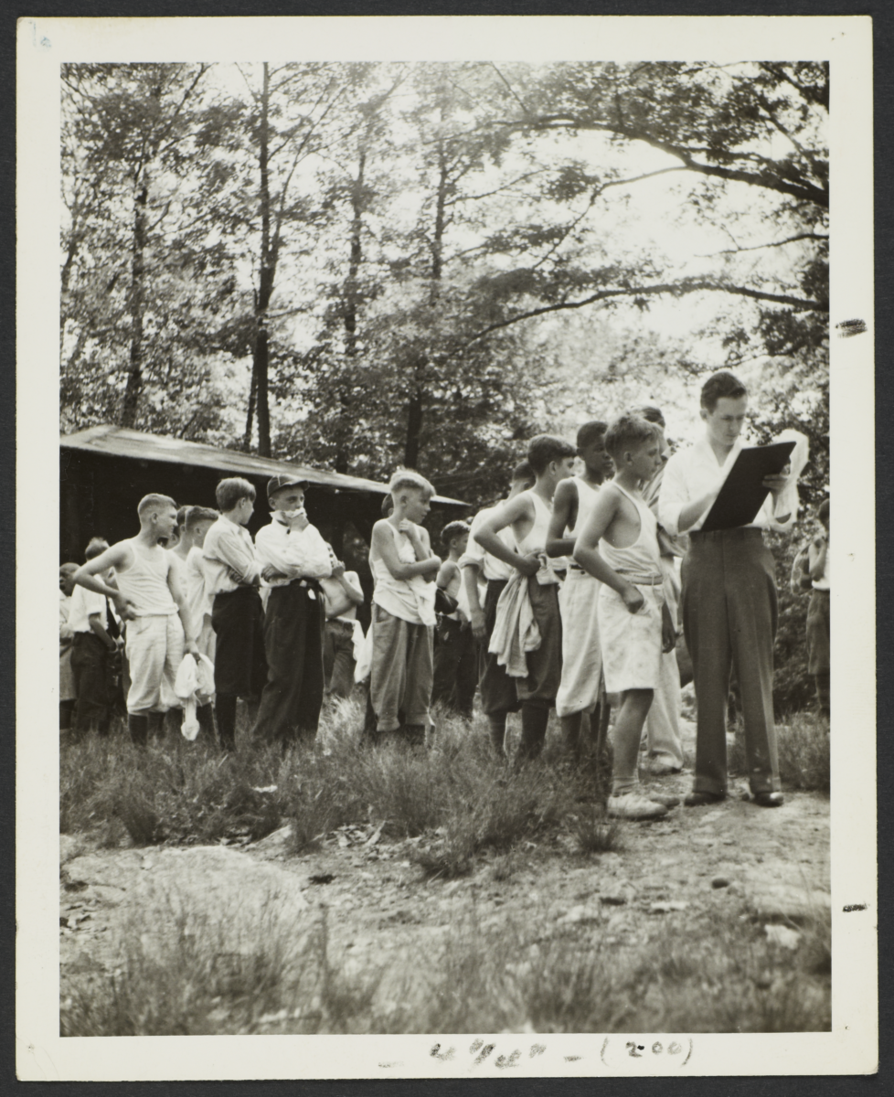 Boys in Line Outside Cabin