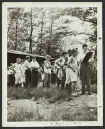Boys in Line Outside Cabin