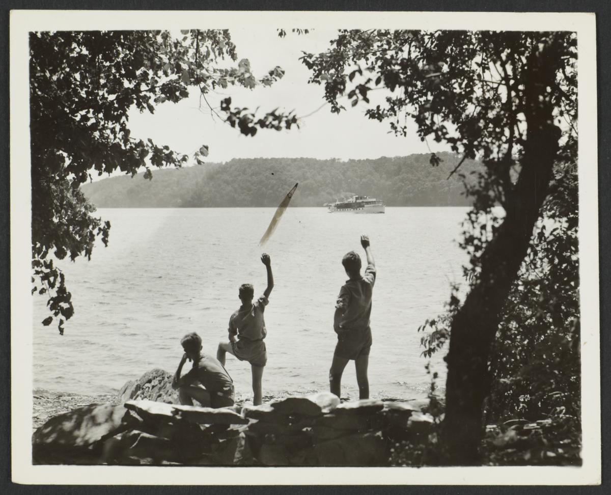 Boys Waving at Boat from Shore
