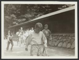 Boys Walking next to Cabin