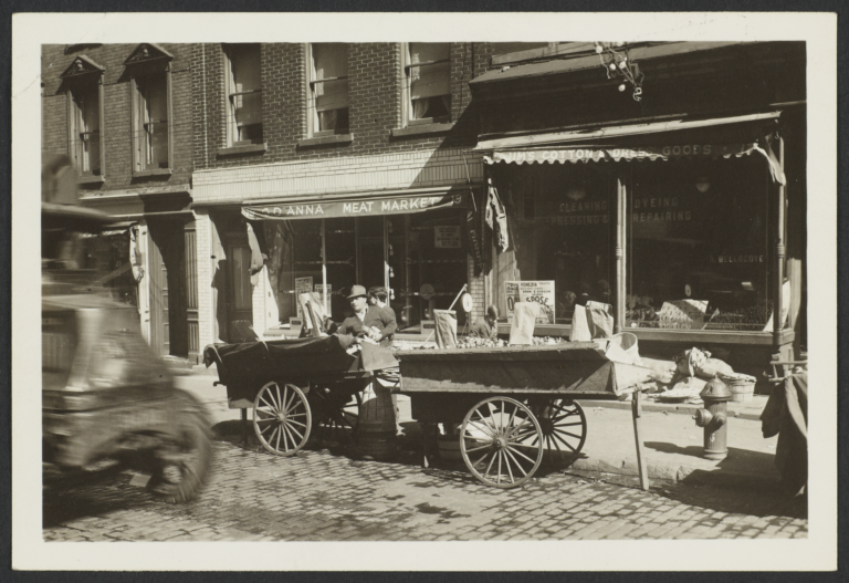 Pushcart in Front of Meat Market