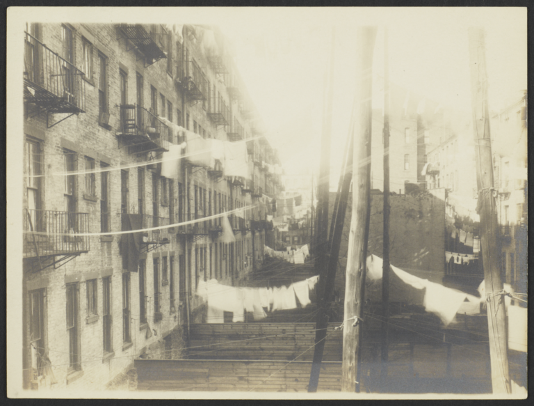 Clotheslines Above Wooden Fences