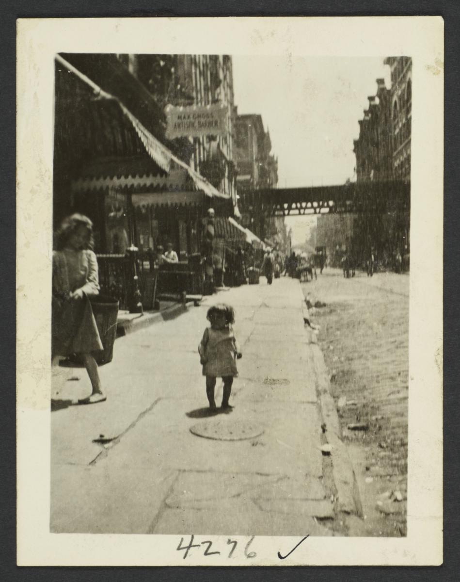 Little Girl on Sidewalk near Elevated Subway