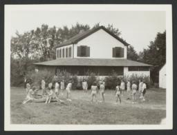 Girls Playing near Cabin