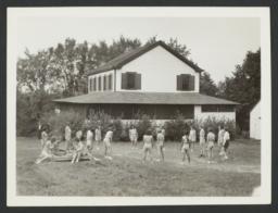 Girls Playing near Cabin