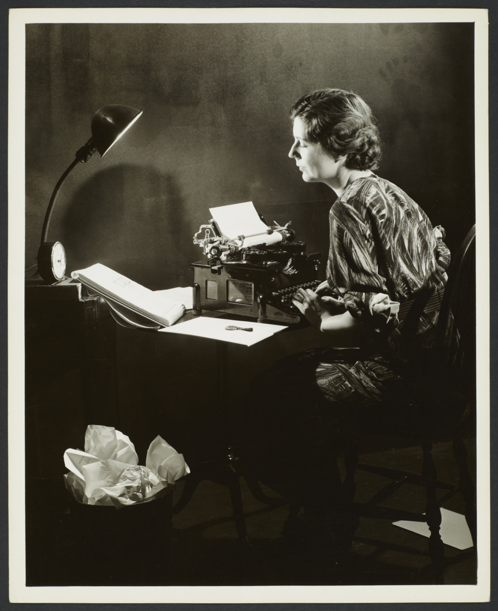 Woman Writing on Typewriter