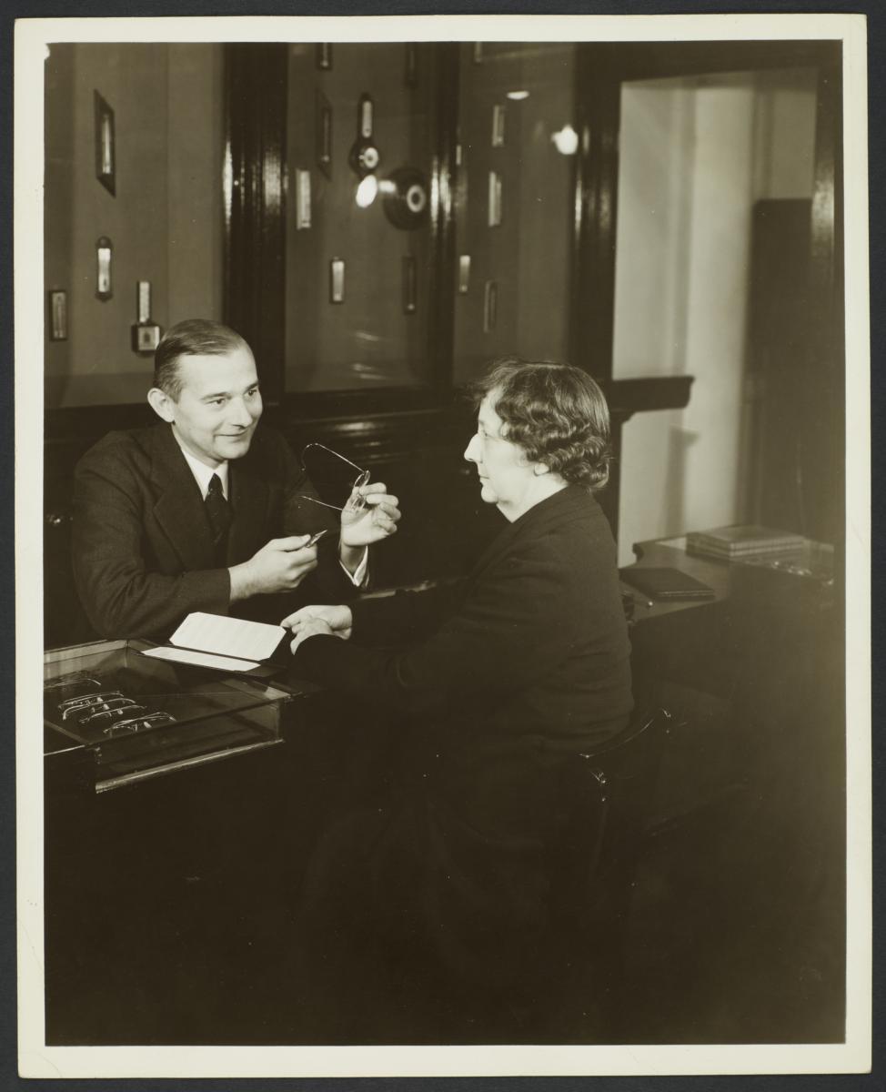 Man Adjusting Eyeglasses for Woman