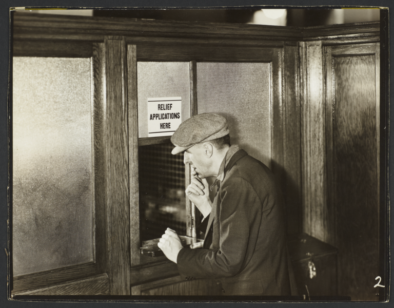 Man at Relief Applications Window
