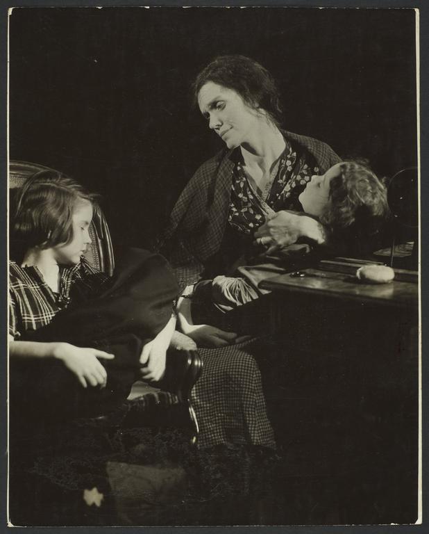 Woman with Children near Desk