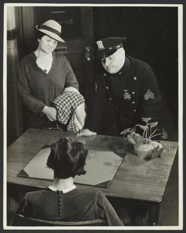 Two Women with Police Officer