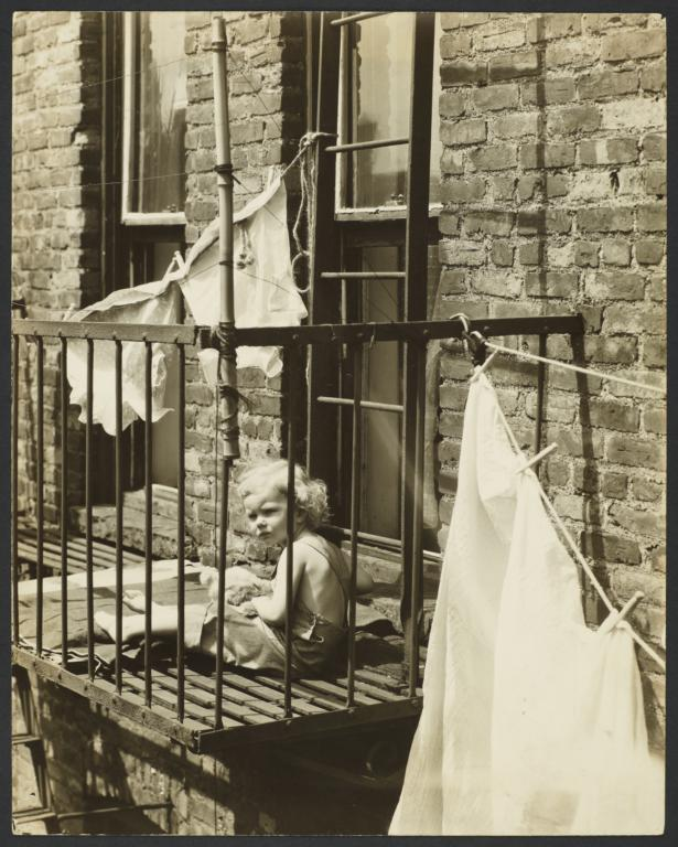 Child with Stuffed Animal on Fire Escape