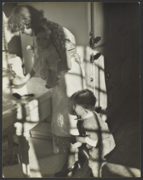 Woman with Two Children near Sink