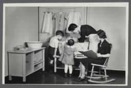"Nurses' Educational ""Keep Well"" Series Album -- Demonstrating Infant Care"