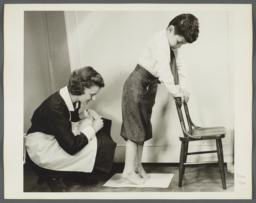 "Nurses' Educational ""Keep Well"" Series Album -- Nurse with Child on Toes"