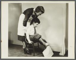 "Nurses' Educational ""Keep Well"" Series Album -- Nurse with Child Exercising Toes"