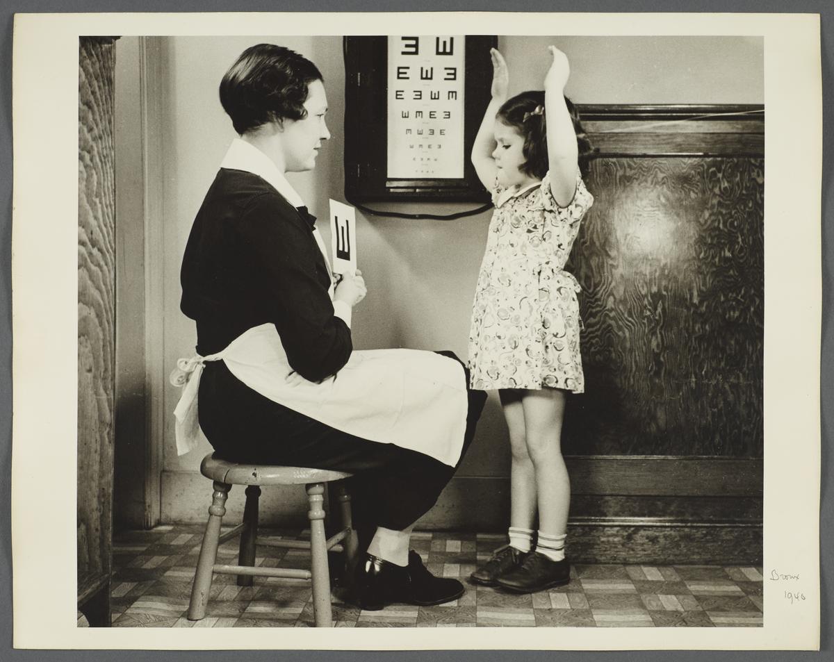 "Nurses' Educational ""Keep Well"" Series Album -- Girl with Arms Raised"