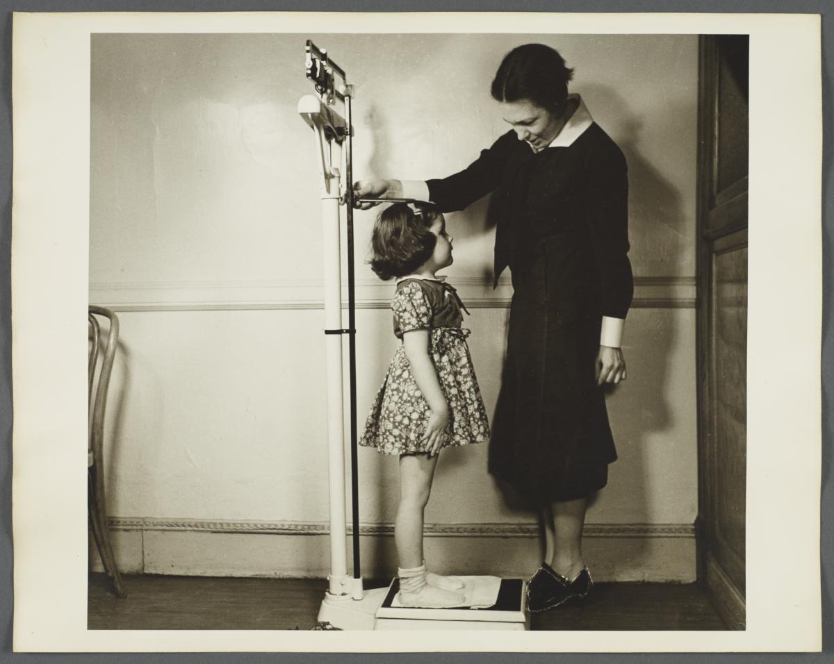 """Nurses' Educational """"Keep Well"""" Series Album -- Nurse Weighing Girl"""