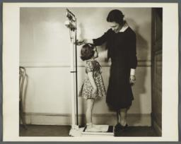 "Nurses' Educational ""Keep Well"" Series Album -- Nurse Weighing Girl"
