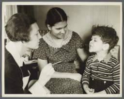 "Nurses' Educational ""Keep Well"" Series Album -- Nurse Inspecting Teeth of Boy"