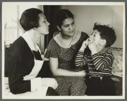 "Nurses' Educational ""Keep Well"" Series Album -- Nurse Inspecting Eyes of Boy"