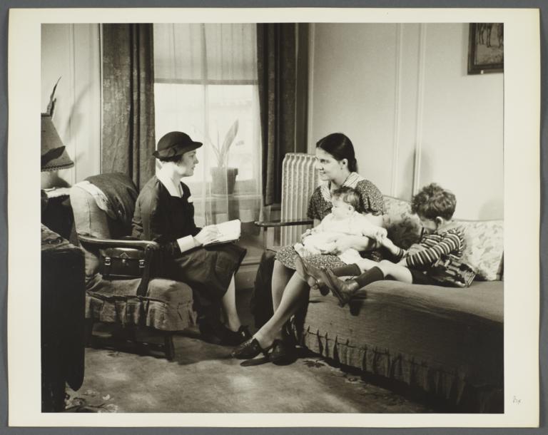 "Nurses' Educational ""Keep Well"" Series Album -- Nurse with Family"