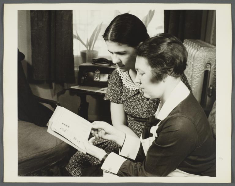 "Nurses' Educational ""Keep Well"" Series Album -- Nurse with Woman Reading Pamphlet"