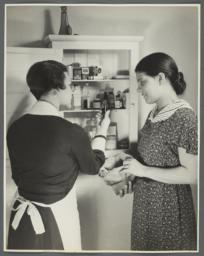 "Nurses' Educational ""Keep Well"" Series Album -- Nurse Inspecting Medicine Cabinet"