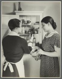 """Nurses' Educational """"Keep Well"""" Series Album -- Nurse Inspecting Medicine Cabinet"""