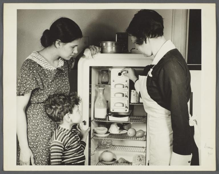 "Nurses' Educational ""Keep Well"" Series Album -- Nurse Inspecting Refrigerator"