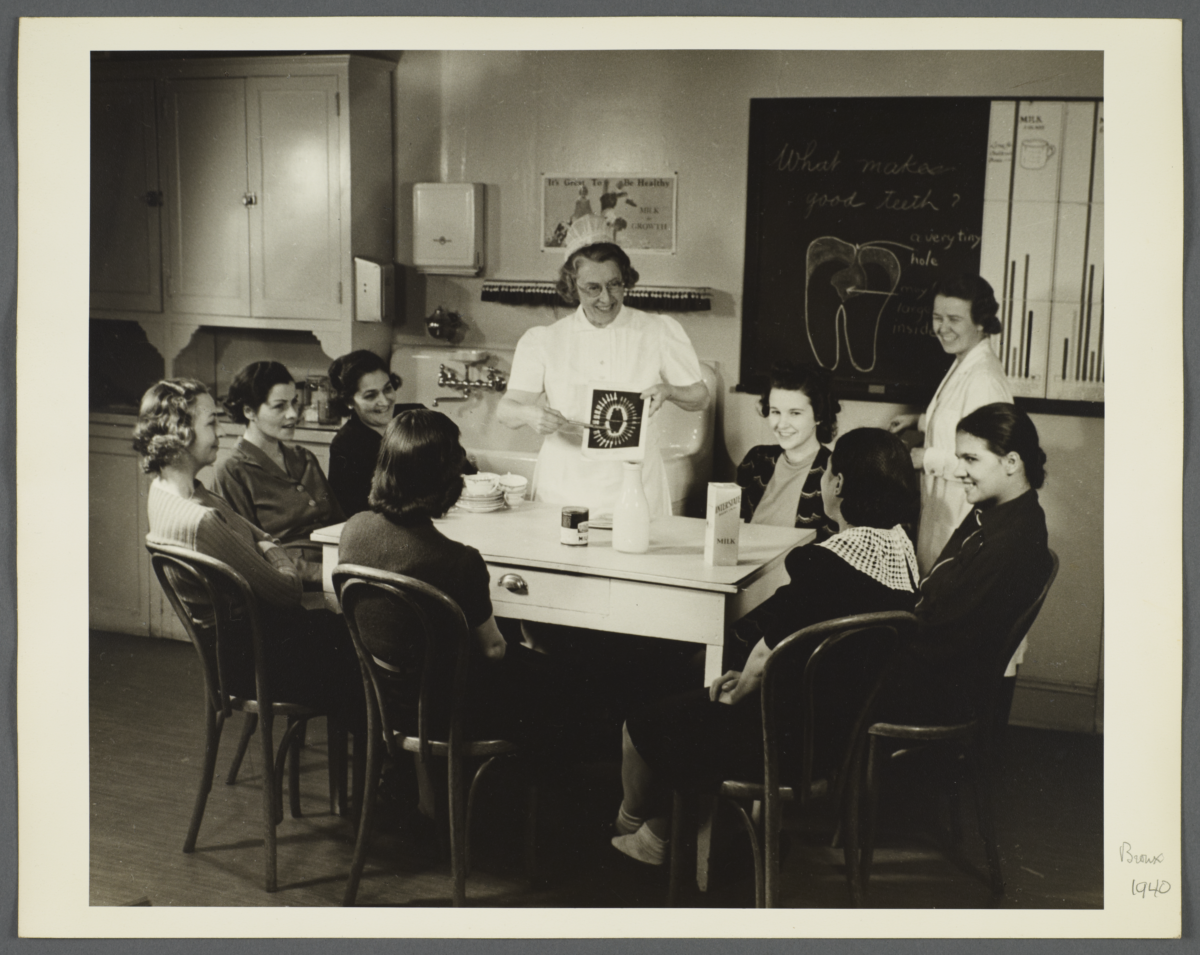 "Nurses' Educational ""Keep Well"" Series Album -- Nurse Instructing Women on Teeth"