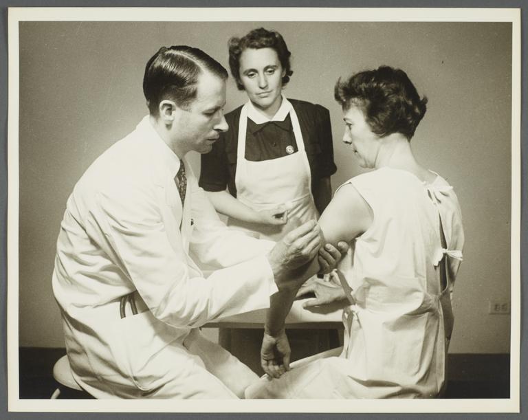 Health Examination-Women Album -- Doctor with Nurse Administering Immunization
